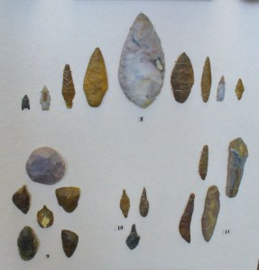 Collection of Neolithic artifacts, including arrowheads and spear points.