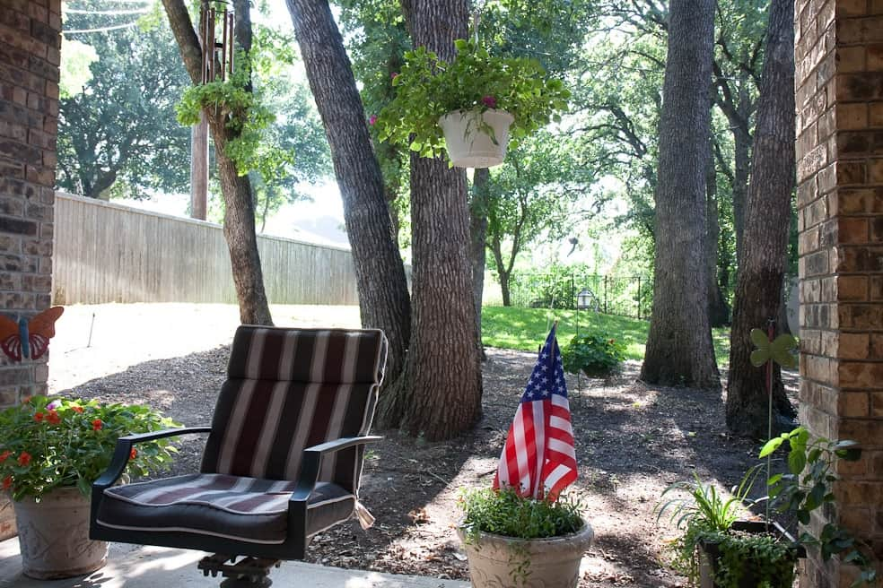 backyard patio with small flag in pot