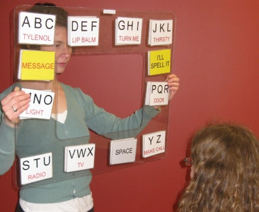 Sppech therapist holding word and letter chart
