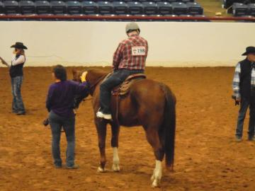 pate ranch horseriding competitor in the ring