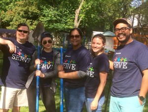 volunteers with rakes and shovels