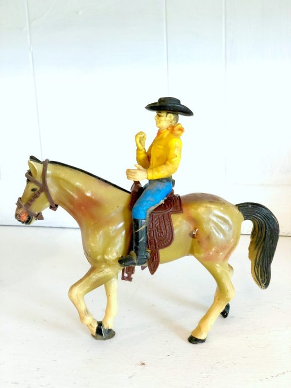 toy horse and cowboy