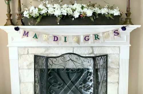 fireplace with Mardi Gras banner