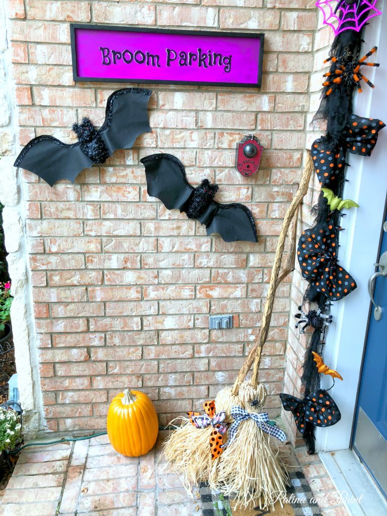 brooms and bats on the front porch
