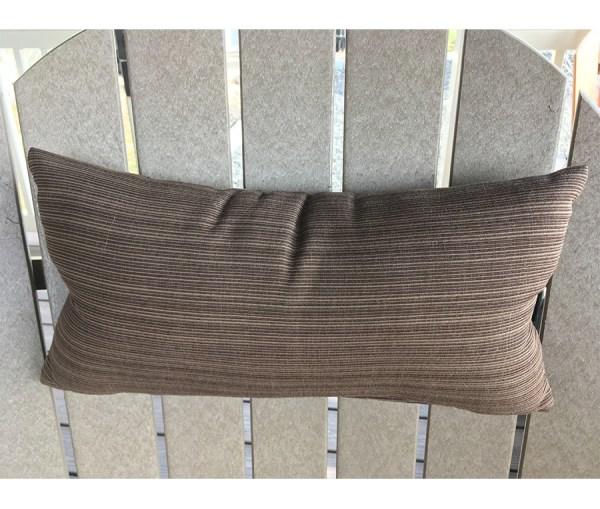 Neck pillow displayed on an adirondack chair.