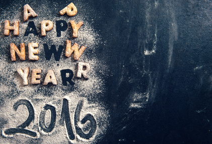 Happy New Year 2016 greeting with cookies letters on dark background with blank space