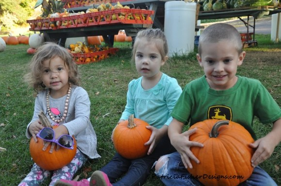 kiddos and their pumpkins