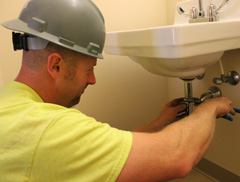 Plumber working on a bathroom sink