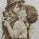 Niños dándose un beso, en punto de cruz