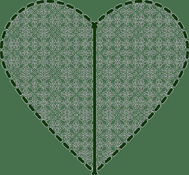 Cojín con corazón de pompones - Patrones gratis