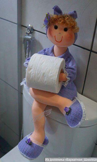 muñeca portarollos