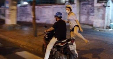 Chasing after Pleasing Vietnamese girls by Motorcycle, Night Avenue of Hochimin, Vietnam 2019 April