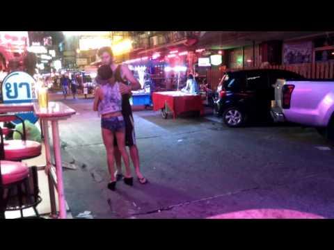 Prankish bargirl at Pattaya nightlife grabs vacationer balls