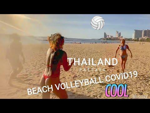 Playing volleyball with enchanting asian ladies. Pattaya shoreline, Thailand