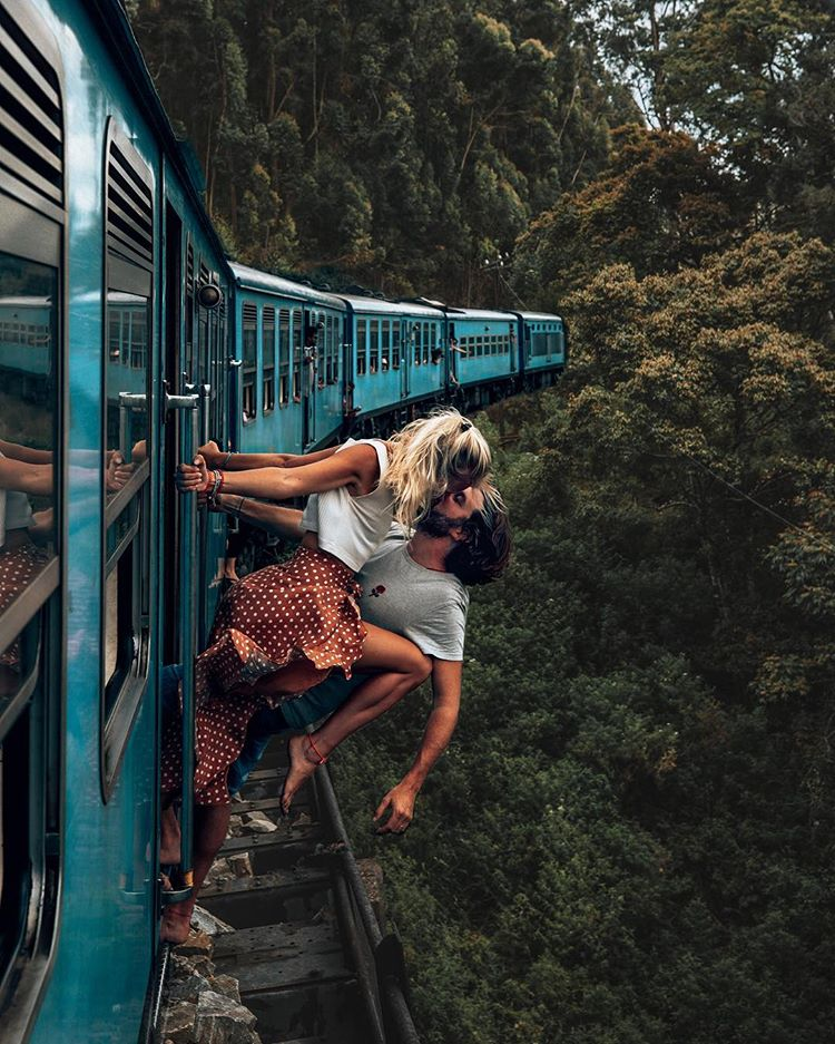 Couple Criticised For Photo Of Them Kissing Hanging From A Moving Train