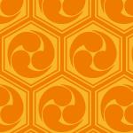 オレンジ色の亀甲三つ巴のパターン