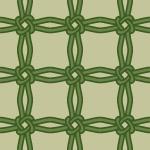 緑色の飾り結びが交差するパターン