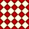 グラデーションがかった赤白のハーリキンチェック柄パターン
