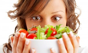 Woman eyes a salad while dating