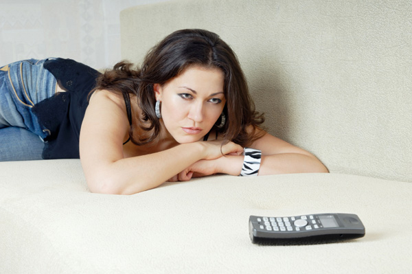 woman-waiting-for-phone-to-ring