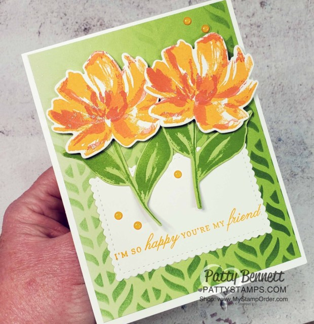 Stampin Up! masks, Blending Brushes and ink pads create a beautiful stenciled background on Oh So Ombre designer paper. Card features the Art Gallery and Delicate Petals stamp sets. by Patty Bennett