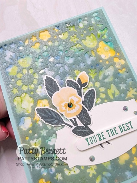 Pansy Petals die cut flower focal point with Shimmer Vellum die cut with Flower Market Die. Card by Patty Bennett