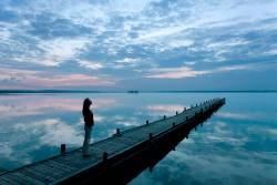 Woman standing on a pier
