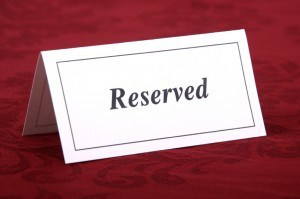 White card Reserved on red background