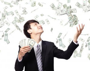 young man with money raining down