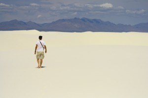 man walking through the desert