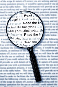"magnifying glass highlighting  the words, ""read the fine print."""