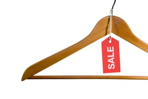 wooden hanger with red sale tag