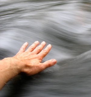 Hand over water