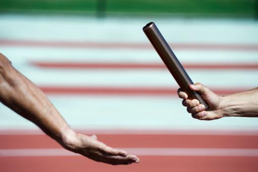 Runners baton handoff