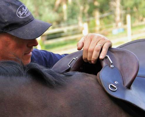 Image of Paul Buckland fitting a saddle