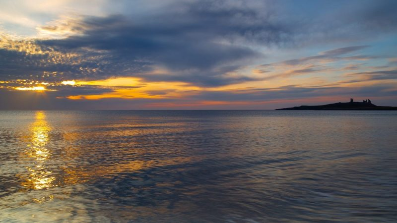 Sunrise over Dunstanburgh