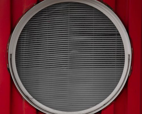 Porthole in container, Docklands, London