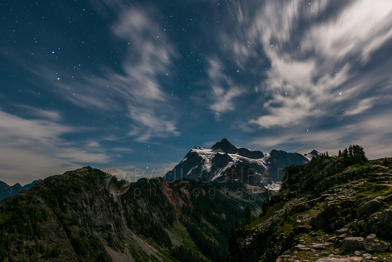 © Paul Conrad/Pablo Conrad Photography - Mt. Shuksan is bathed in moonglow as stars leave trails as seen from Artist Point in the Mt. Baker-Snoqualime National Forest in western Whatcom County east of Bellingham, Wash.