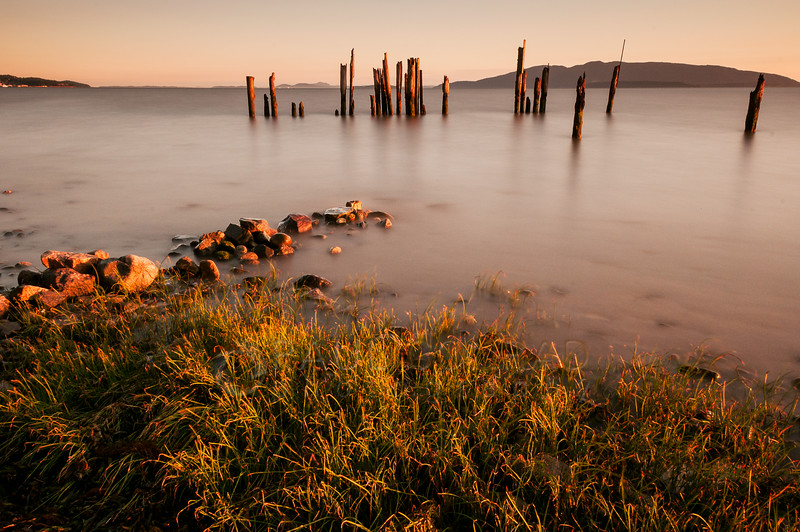 © Paul Conrad/Pablo Conrad Photography - A long exposure of 150 seconds softens the waves of the rising tide at Locust Beach along the Bellingham Bay in Bellingham, Wash.