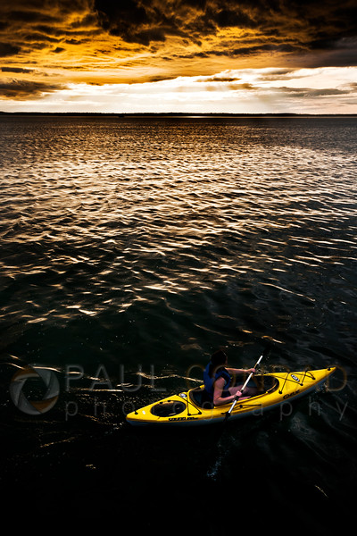 © Paul Conrad/Pablo Conrad Photography - A kayaker paddles on Bellingham Bay under a brilliant sky near the Boardwalk in Boulevard Park in Bellingham, Wash., on Tuesday evening June 25, 2013.