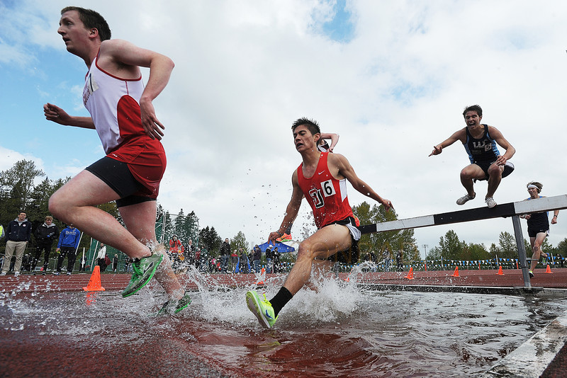 © Paul Conrad/The Bellingham Herald - Olympic College's Keith Ryan, left leads Seattle University's Nathan McLaughlin and Western Washington University's Noah Ripley as they tackle the Men's 3000m Steeplechase during the 2014 Ralph Vernacchia Track and Field Meet at Civic Field in Bellingham, Wash., on Saturday April 26, 2014. McLaughlin came in fourth with a time of 9 min. 42.72 seconds. Western Washington's Matt Lutz won the event with the time 9:24.95 with WWU's Joshua Reitner on his heels earning second with a time of 9 min. 38.58 seconds.