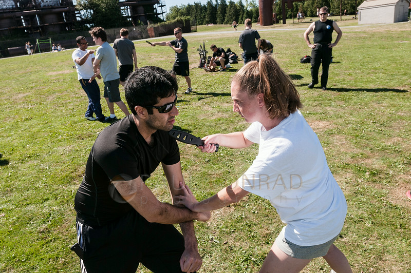 © Paul Conrad/Pablo Conrad Photography - Students practice knife fighting at Gasworks Park in Seattle, Wash.