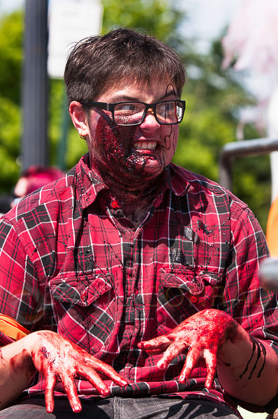© Paul Conrad/The Bellingham Herald - Hayden Nupcharoen, 16, of Bellingham, gets into character before the start of the fifth annual Zombies vs. Survivors at Maritime Heritage Park on Saturday  May 31, 2014, in Bellingham, Wash. His dad Bill and little sister Ryle also played the part zombies.