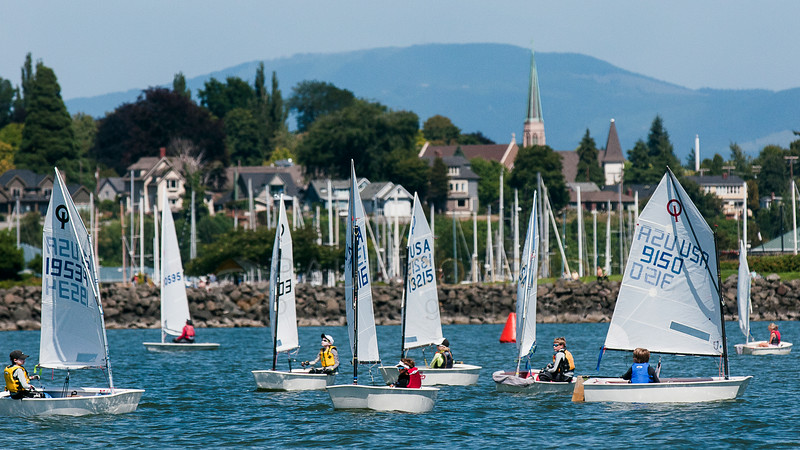 © Paul Conrad/The Bellingham Herald - Youth in the Opti racing division begin their approach to the finish line during the first race of the annual Bellingham Youth Regatta on Saturday afternoon August 9, 2014, on Bellingham Bay in Bellingham, Wash. Dozens of youth from ages 6 and up raced in 5 categories.