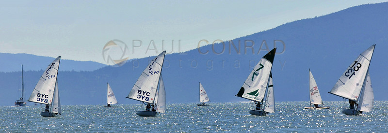© Paul Conrad/The Bellingham Herald - Racers in the FJ class turn towards the second marker after completing their turn from the first during the annual Bellingham Youth Regatta on Saturday afternoon August 9, 2014, on Bellingham Bay in Bellingham, Wash. Dozens of youth from ages 6 and up raced in 5 categories.