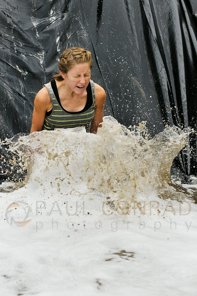 © Paul Conrad/The Bellingham Herald - A competitor plunges into the deep foam of the  Mud Pit Slip & Slide during the 3rd annual Mud to Suds race on Saturday morning August 16, 2014, at Hovander Park in Ferndale, Wash. Nearly 2000 people ran the 2.5 mile course negotiating 22 obstacles including mud-filled pits, hay bales, and a soap foam tunnel. The event raised funds for the Girls Scouts of Western Washington.