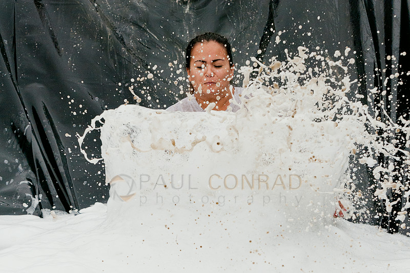 © Paul Conrad/The Bellingham Herald - Nympha Evans (cq) of Oak Harbor, Wash., plunges into the Mud Pit Swim & Slide during the 3rd annual Mud to Suds race on Saturday morning August 16, 2014, at Hovander Park in Ferndale, Wash. Nearly 2000 people ran the 2.5 mile course negotiating 22 obstacles including mud-filled pits, hay bales, and a soap foam tunnel. The event raised funds for the Girls Scouts of Western Washington.