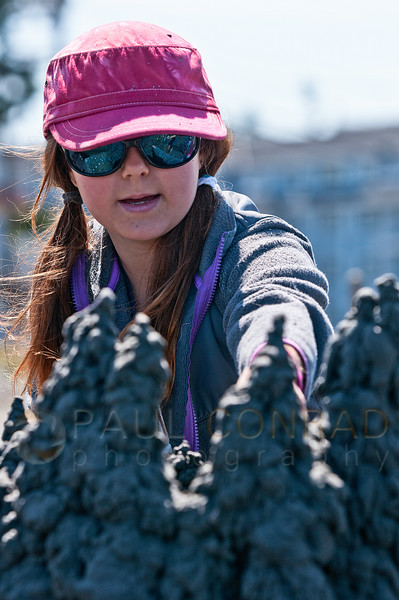 "© Paul Conrad/The Bellingham Herald - Corrine Campion, 6, works on her sculpture ""Yertle the Turtle"" during the 31st Annual Birch Bay Sand Sculpture Contest on Birch Bay Beach on Saturday morning June 14, 2014, in Birch Bay, Wash."