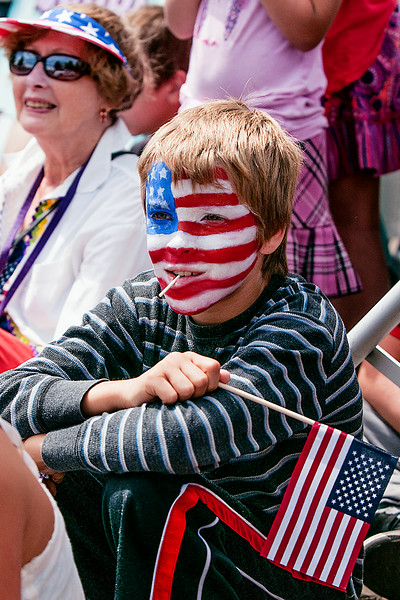 © Paul Conrad/The Bellingham Herald - Canadian Aiden Mufti, 12, of Vancouver, B.C., watches the festivities during the Old Fashioned 4th of July parade in Downtown Blaine, Wash.,  on Friday July , 2014.  Thousands lined Peace Portal Drive to watch almost 100 floats pass by in this year's parade.
