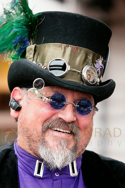 © Paul Conrad/The Bellingham Herald - Inocencio Valderrama of Bellingham works his booth during the Fairhaven Steampunk Festival at Fairhaven Village Green in Fairhaven, Wash.,  on Saturday afternoon July 19, 2014. Hundreds enjoyed the sights of individuals dressed in Steampunk Victorian costumes, live entertainment, food and vendors .